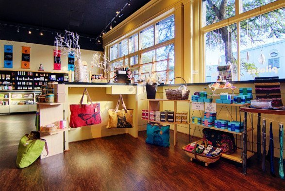 Large windows let in natural light to a spa boutique full of spa items for sale.